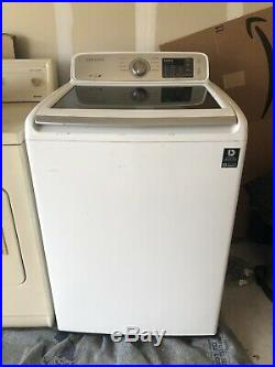 Used Samsung 4.5 cu. Ft. Top Load Washer and Kenmore Heavy Dryer (Electric)